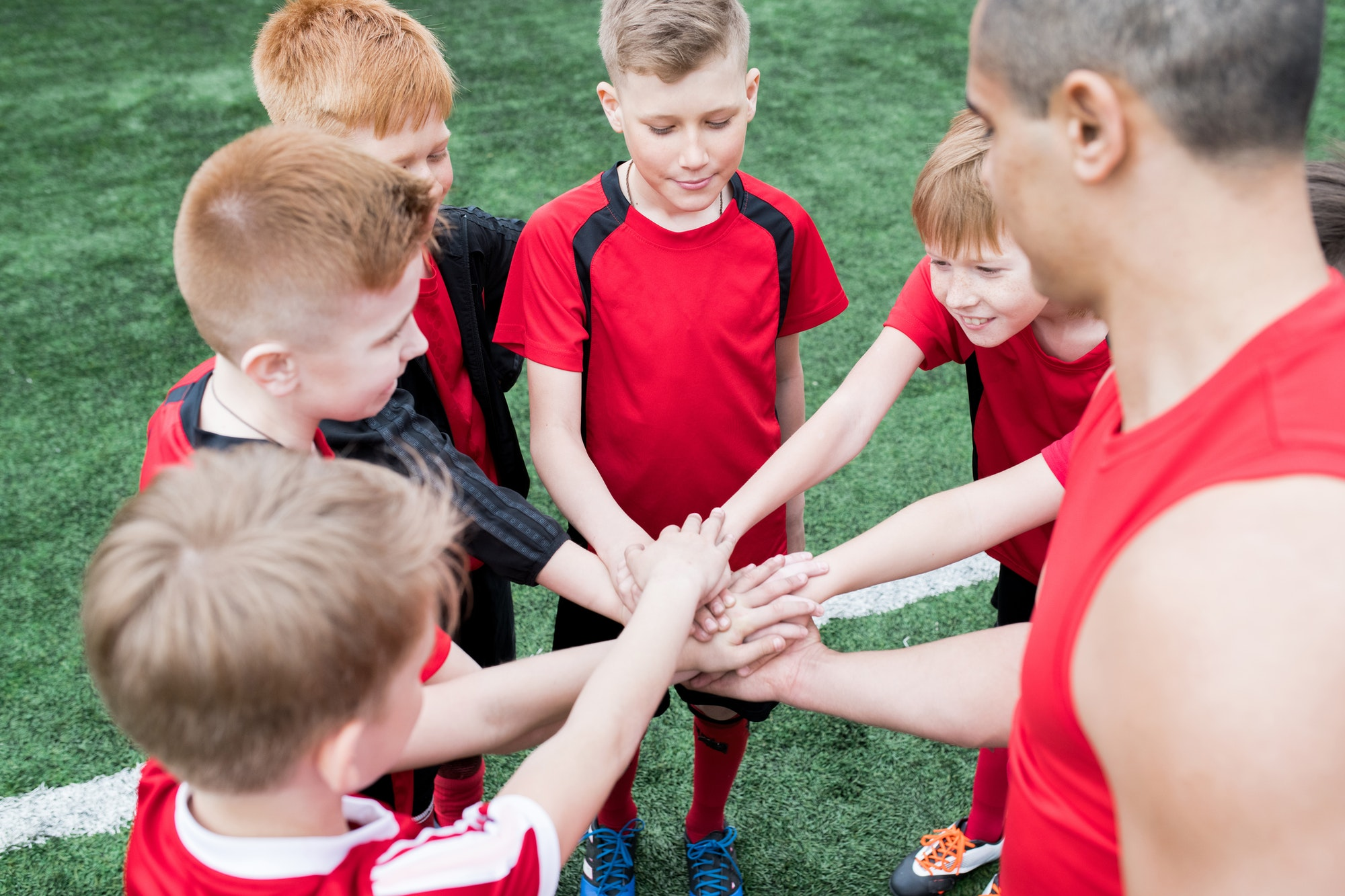 kids-joining-hands-before-match.jpg