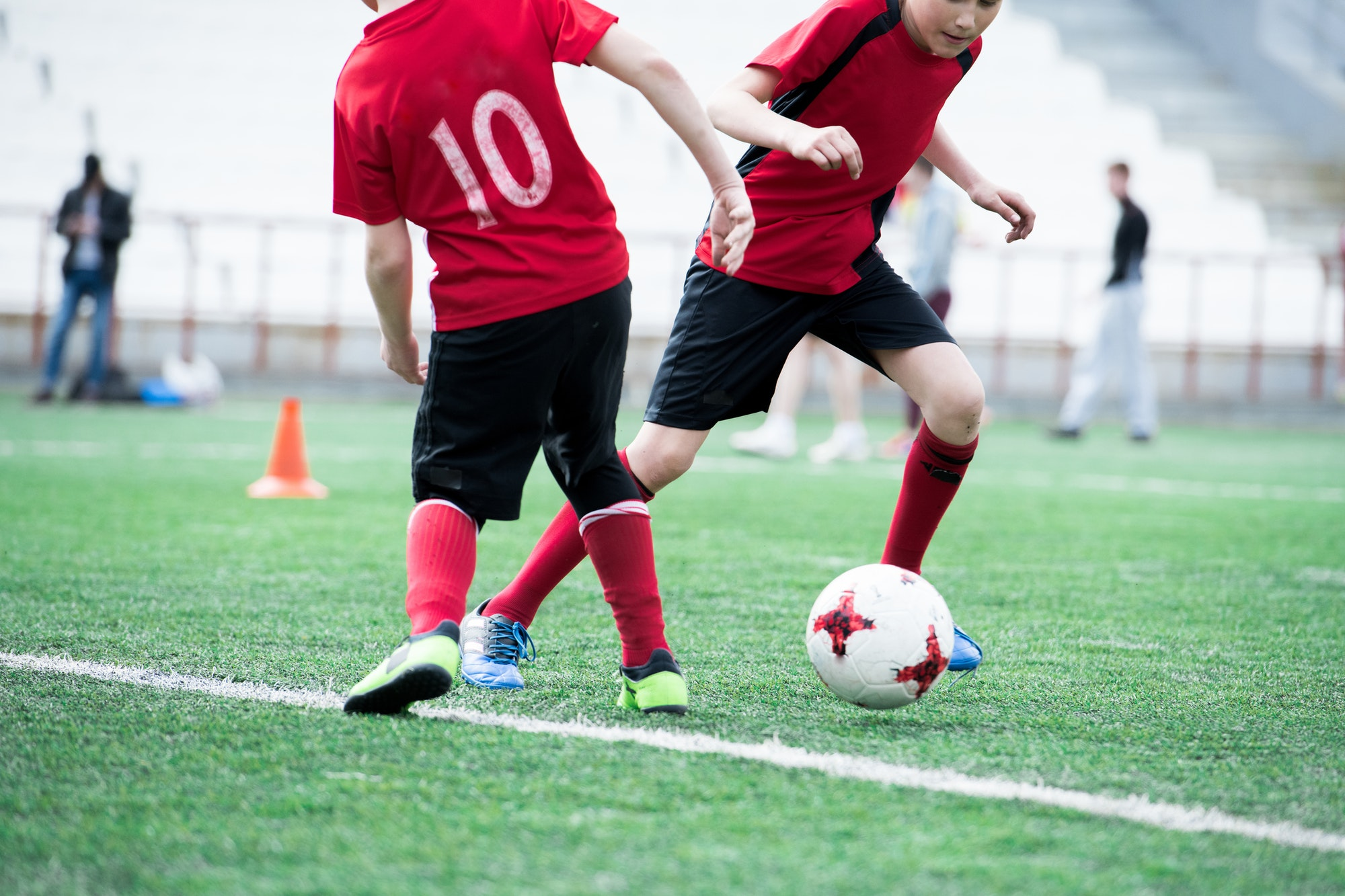 two-kids-playing-football.jpg